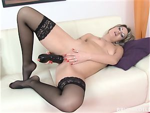 Tattood blonde Laura spunking from a truly yam-sized dildo