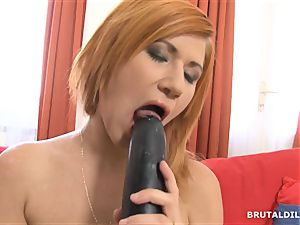 Strawberry blond cutie swallowing a thick brutal fuck stick