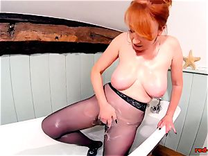 crimson hard-core frolicking with her cooch while in tights