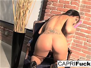 Capri Plays With Her unbelievable funbags And tight raw slit