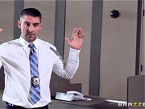 Bridgette B climbs aboard a randy cops prick