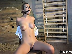 gagged stunner climaxes during bondage