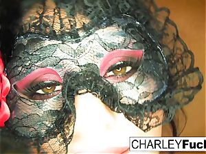 Charley wears some stunning undergarments and stocking
