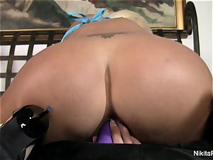 molten light-haired Nikita plays with a purple toy