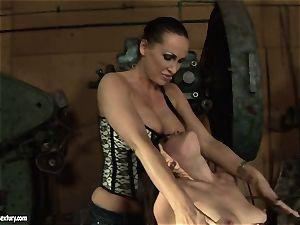 Mandy Bright fingerblasting a warm girl in a machine shop